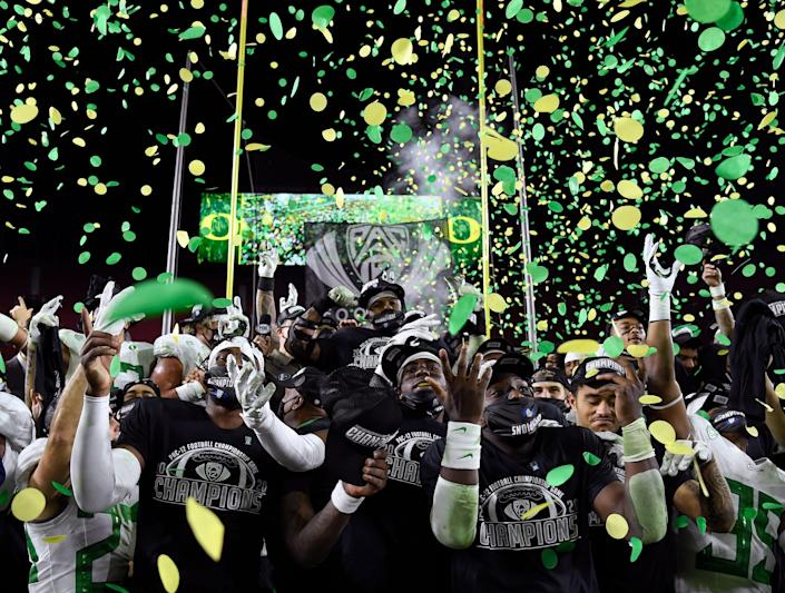 Oregon Ducks celebrate a 31-24 win over the USC Trojans during the Pac-12 championship.