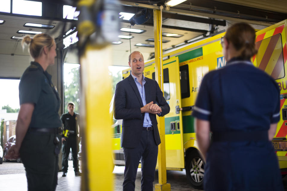 The Duke of Cambridge meets paramedic staff, maintaining social distancing, from the East of England Ambulance Service Trust during a visit to the Ambulance Station in King's Lynn, Norfolk.