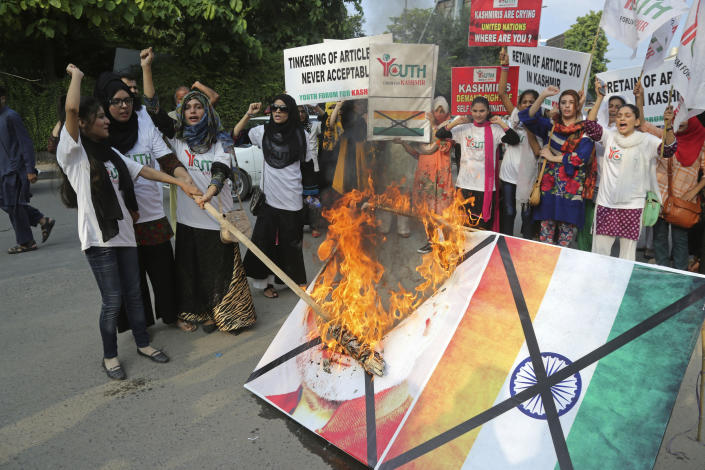 Pakistani students burn a poster of Indian Premier Narendra Modi during an anti-Indian rally in Lahore, Pakistan, Wednesday, Aug. 7, 2019. Pakistan has decided to downgrade its diplomatic ties with neighboring India and suspend bilateral trade in response to New Delhi's decision to reduce the special status of Kashmir, a Himalayan region claimed by both countries. (AP Photo/K.M. Chaudary)