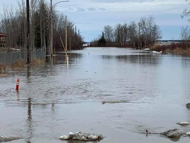 A road flooded in Fort Simpson, N.W.T, on Saturday, one day before a general evacuation was called for the town.