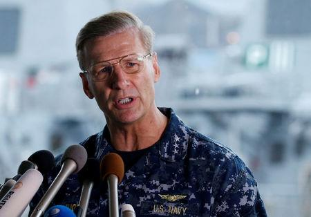 FILE PHOTO: Vice Admiral Joseph Aucoin, U.S. 7th Fleet Commander, speaks to media on the status of the U.S. Navy destroyer USS Fitzgerald, damaged by colliding with a Philippine-flagged merchant vessel, and the seven missing Fitzgerald crew members, at the U.S. naval base in Yokosuka, south of Tokyo, Japan June 18, 2017. REUTERS/Toru Hanai/File photo