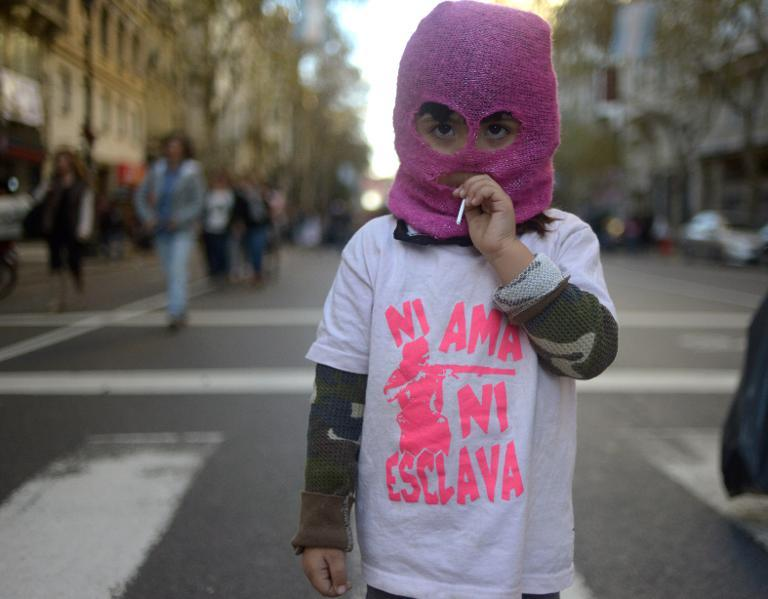 "A girl wears a t-shirt reading ""Neither mistress nor slave"" as she takes part in a demonstration against femicide in Buenos Aires on June 3, 2015"