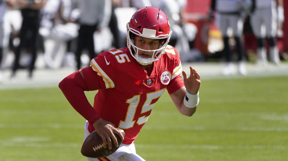 Kansas City Chiefs quarterback Patrick Mahomes runs the ball against the Las Vegas Raiders during the first half of an NFL football game, Sunday, Oct. 11, 2020, in Kansas City. (AP Photo/Charlie Riedel)