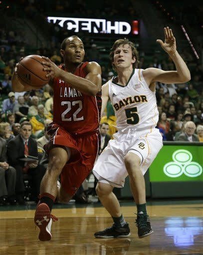 Lamar guard Donley Minor (22) drives to the basket past Baylor's Brady Heslip (5) in the first half of an NCAA college basketball game on Wednesday, Dec. 12, 2012, in Waco, Texas. (AP Photo/Tony Gutierrez)