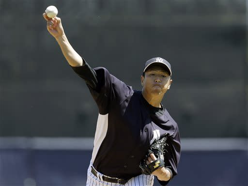 New York Yankees starting pitcher Hiroki Kuroda, of Japan, delivers a warmup pitch for a spring training baseball game against the Pittsburgh Pirates at Steinbrenner Field in Tampa, Fla., Thursday, March 28, 2013. (AP Photo/Kathy Willens)