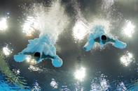 LONDON, ENGLAND - JULY 30: (L-R) Yuan Cao and Yanquan Zhang of China compete in the Men's Synchronised 10m Platform Diving on Day 3 of the London 2012 Olympic Games at the Aquatics Centre on July 30, 2012 in London, England. (Photo by Adam Pretty/Getty Images)