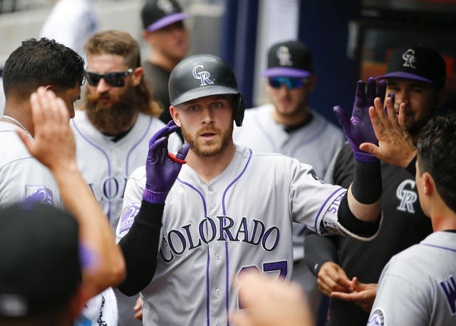Colorado Rockies Trevor Story celebrates hitting a solo home run with teammates in the dugout in the second inning of a baseball game against the Atlanta Braves, Sunday, Aug. 19, 2018, in Atlanta. (AP Photo/Todd Kirkland)
