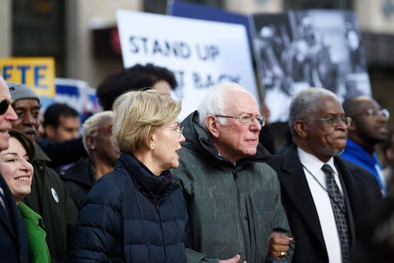 Sens. Bernie Sanders and Elizabeth Warren link arms and talk during a Martin Luther King Jr. Day march in Columbia, South Carolina on Monday   Meg Kinnard/AP/Shutterstock