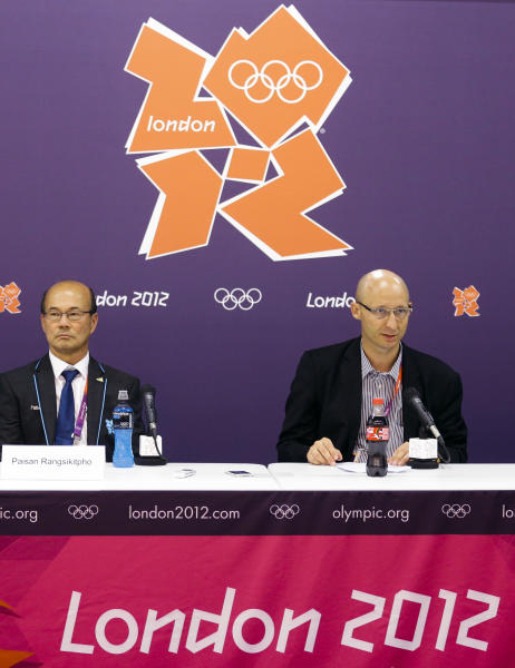 """Chief Operating Officer Thomas Lund, right, and Deputy President Paisan Rangsikitpho, of the Badminton World Federation, appear during a news conference announcing the elimination of eight female badminton doubles players at the 2012 Summer Olympics, Wednesday, Aug. 1, 2012, in London. The Badminton World Federation announced its ruling after investigating two teams from South Korea and one each from China and Indonesia. It punished them for """"not using one's best efforts to win a match"""" and """"conducting oneself in a manner that is clearly abusive or detrimental to the sport"""" in matches Tuesday night. (AP Photo/Markus Schreiber)"""