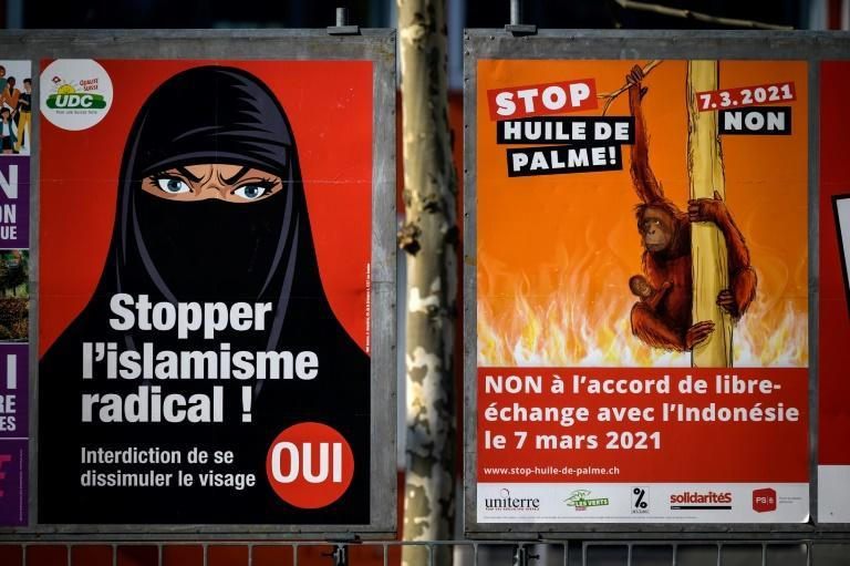"Campaign posters reading ""Stop radical Islam!"" and ""Stop extremism!"", featuring a woman in a black niqab, have been plastered around Swiss cities"