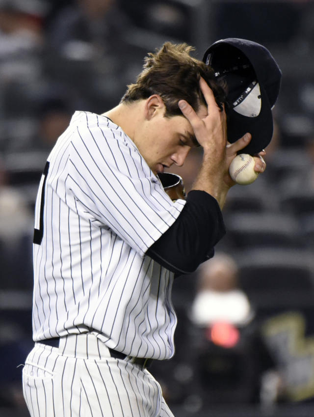 New York Yankees pitcher Nathan Eovaldi reacts during the sixth inning of a baseball game against the Boston Red Sox, Friday, April 10, 2015, at Yankee Stadium in New York. (AP Photo/Bill Kostroun)