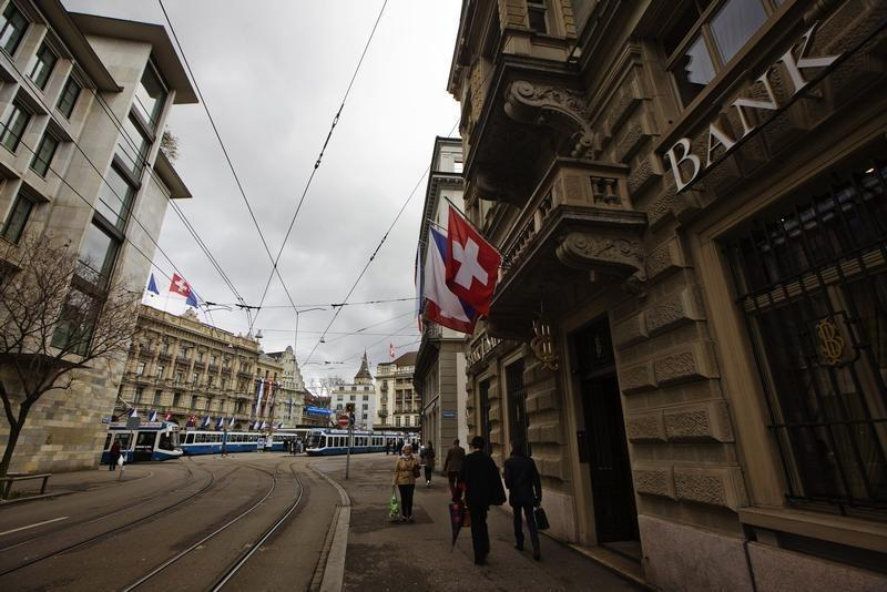 People walk past the building of the bank Safra next to the Paradeplatz square in Zurich