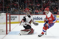 Arizona Coyotes goaltender Antti Raanta (32), of Finland, reacts after he let in a goal to Washington Capitals center Evgeny Kuznetsov (92), of Russia, during the second period of an NHL hockey game, Monday, Nov. 11, 2019, in Washington. (AP Photo/Nick Wass)