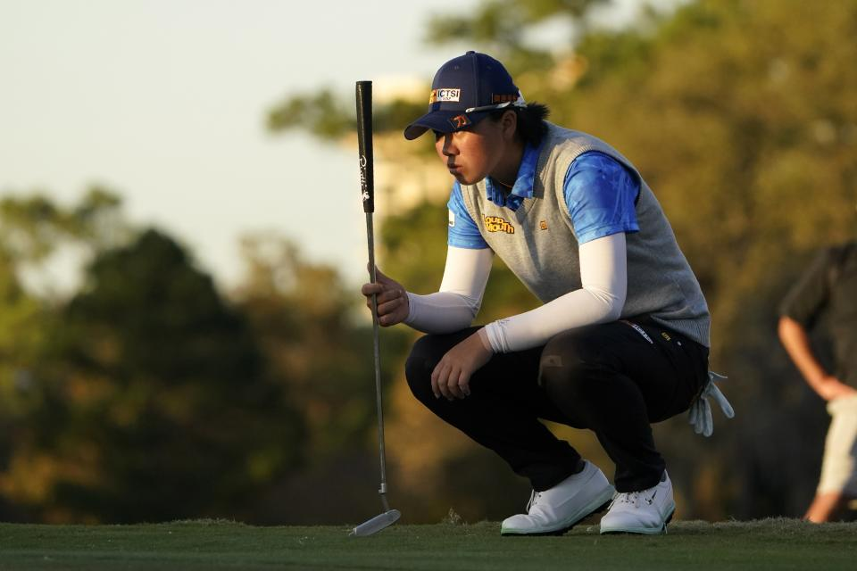 Yuka Saso, of the Philippines, lines up her putt on the 18th green during the first round of the U.S. Women's Open golf tournament in Houston, Thursday, Dec. 10, 2020. (AP Photo/Eric Gay)