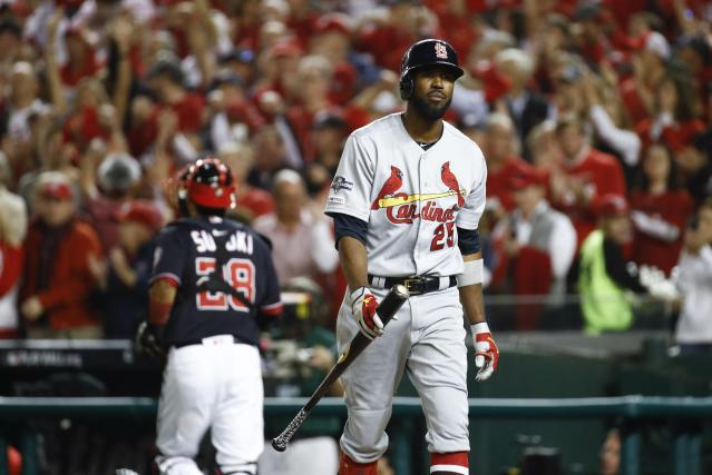 St. Louis Cardinals' Dexter Fowler reacts after striking out during the third inning of Game 3 of the baseball National League Championship Series against the Washington Nationals Monday, Oct. 14, 2019, in Washington. (AP Photo/Patrick Semansky)