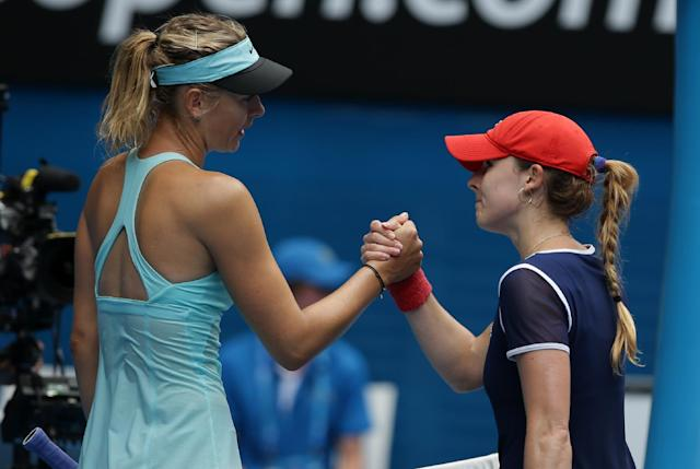 Maria Sharapova, left, of Russia is congratulated by Alize Cornet of France after winning their third round match at the Australian Open tennis championship in Melbourne, Australia, Saturday, Jan. 18, 2014.(AP Photo/Aaron Favila)