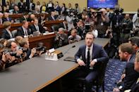 <p>Facebook co-founder, Chairman and CEO Mark Zuckerberg arrives to testify before the House Energy and Commerce Committee in the Rayburn House Office Building on Capitol Hill April 11, 2018 in Washington, DC. This is the second day of testimony before Congress by Zuckerberg, 33, after it was reported that 87 million Facebook users had their personal information harvested by Cambridge Analytica, a British political consulting firm linked to the Trump campaign. </p>