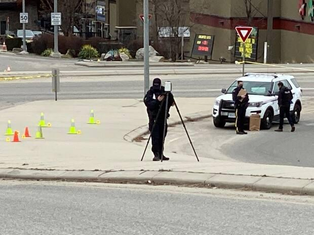 The Kelowna RCMP Major Crimes Unit closed off Highway 97 on March 21, 2021, to investigate a murder police say was targeted. (CBC - image credit)