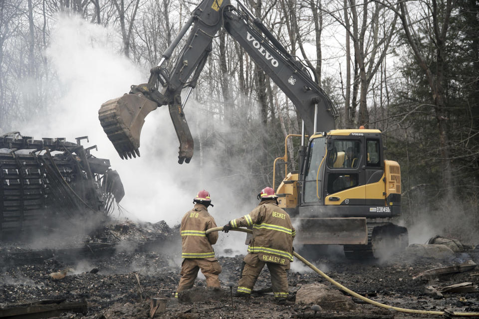 Firefighters work to extinguish the Doris Duke Theatre at Jacob's Pillow in Becket, Mass., that burned in an early morning fire, Tuesday, Nov. 17, 2020. The Doris Duke Theatre is one of two indoor theaters on the grounds of Jacob's Pillow. (Ben Garver/The Berkshire Eagle via AP)