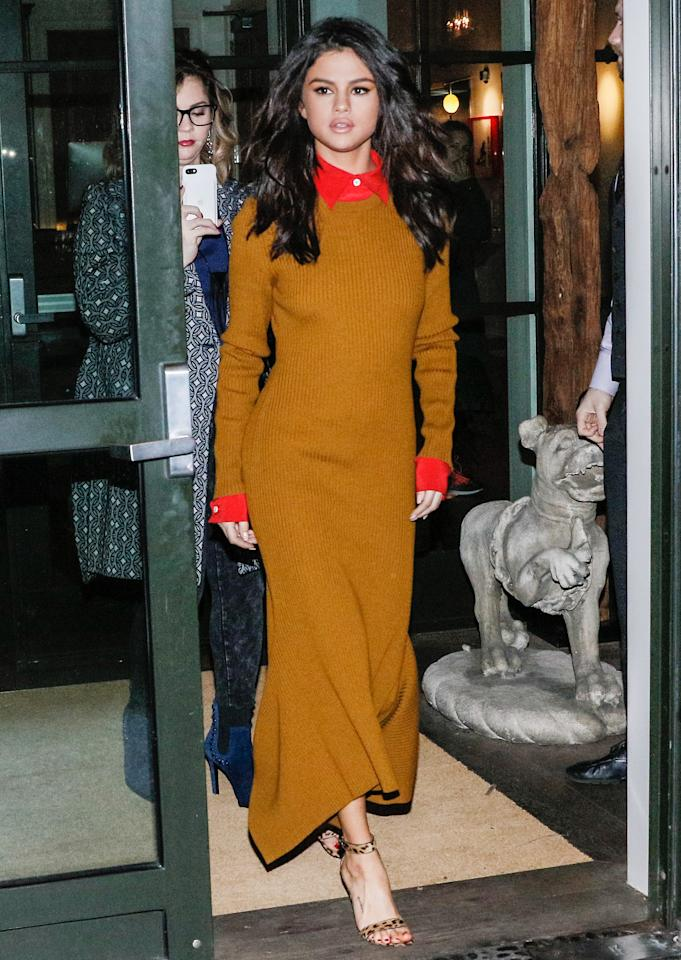 <p>The singer stunned in N.Y.C. in a mustard-colored ribbed Victoria Beckham dress with a red collar and cuffs. She paired the look with leopard-print sandals and loose, sexy waves.</p>