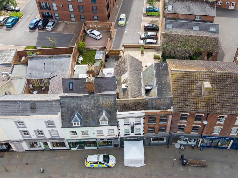 Police activity at The Clean Plate cafe in Southgate Street, Gloucester, where excavation work is to beginJoe Giddens/PA