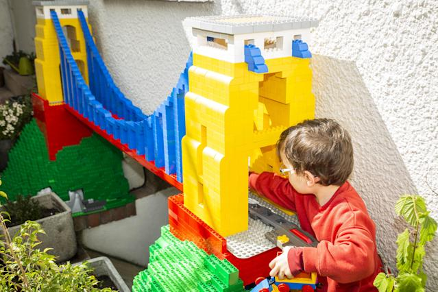 John Ford built a huge Duplo train track for his two sons to play with during lockdown. (SWNS)