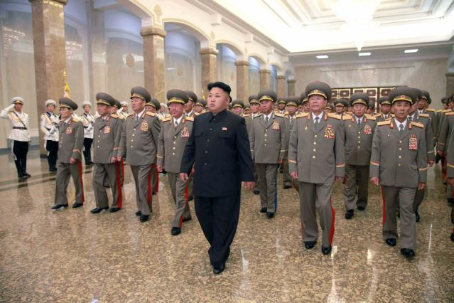 North Korean leader Kim Jong Un (C) visits the Kumsusan Palace of the Sun at midnight on Tuesday on the occasion of the 20th anniversary of the demise of President Kim Il Sung in this photo released by North Korea's Korean Central News Agency (KCNA) in Pyongyang July 8, 2014. North Korean leader Kim Jong Un limped on to the stage on the anniversary of his grandfather's death, footage broadcast by state media on Tuesday showed. in a rare display of weakness in a country where leaders are portrayed as semi-divine. REUTERS/KCNA (NORTH KOREA - Tags: ANNIVERSARY POLITICS TPX IMAGES OF THE DAY) ATTENTION EDITORS - THIS PICTURE WAS PROVIDED BY A THIRD PARTY. REUTERS IS UNABLE TO INDEPENDENTLY VERIFY AU NTICITY, CONTENT, LOCATION OR DATE THIS IMAGE THIS PICTURE IS DISTRIBUTED EXACTLY AS RECEIVED BY REUTERS, AS A SERVICE TO CLIENTS FOR EDITORIAL USE ONLY. NOT FOR SALE FOR MARKETING OR ADVERTISING CAMPAIGNS. THIS IMAGE HAS BEEN SUPPLIED BY A THIRD PARTY. IT IS DISTRIBUTED, EXACTLY AS RECEIVED BY REUTERS, AS A SERVICE TO CLIENTS. NO THIRD PARTY SALES. NOT FOR USE BY REUTERS THIRD PARTY DISTRIBUTORS. SOUTH KOREA OUT. NO COMMERCIAL OR EDITORIAL SALES IN SOUTH KOREA