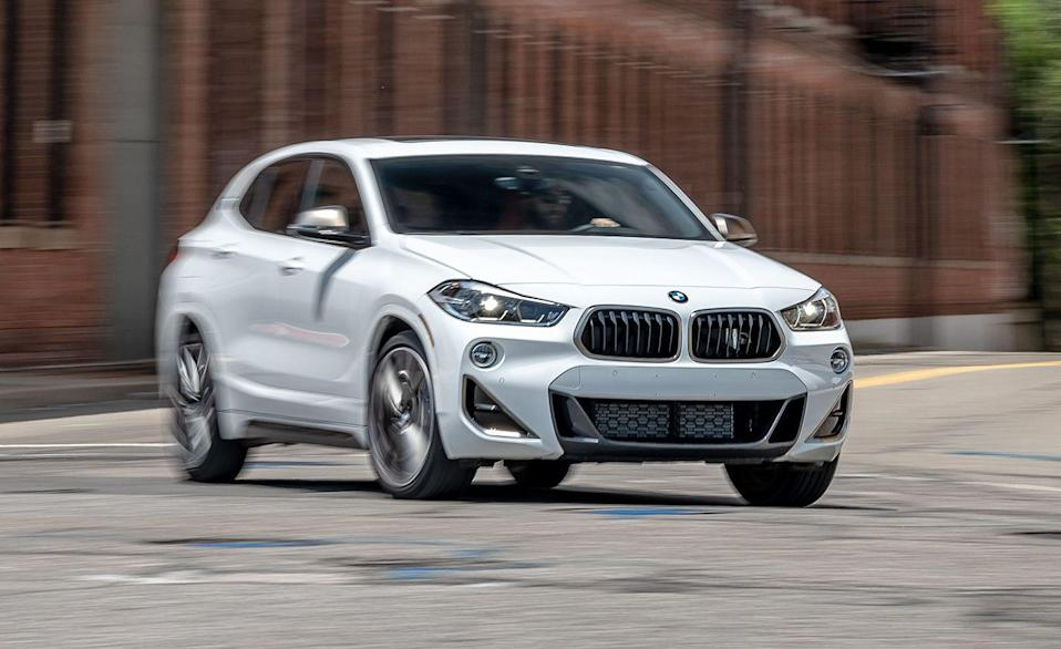 """<p>Though it shares its underpinnings with the more mature-looking X1, the <a href=""""https://www.caranddriver.com/bmw/x2"""" rel=""""nofollow noopener"""" target=""""_blank"""" data-ylk=""""slk:BMW X2"""" class=""""link rapid-noclick-resp"""">BMW X2</a> is third in this ranking because a podium has three steps. The base X2 is powered by a 228-hp turbocharged inline-four with an eight-speed automatic and front-wheel drive. All-wheel drive is an extra $2000. A zestier 302-hp engine is offered in the X2 M35i, the same one that comes on the 2-series Gran Coupe M235i xDrive, and that model gets to 60 mph in 4.5 seconds, nearly two seconds quicker than the base engine. The fast version adds over $10,000 to the base price, so if you can stomach that, you'll be rewarded with a strong powertrain and zesty exhaust note.</p><ul><li>Base price: $37,945</li><li>EPA Fuel Economy combined/city/highway: 27/24/32 mpg</li><li>Rear cargo space: 21 cubic feet</li></ul><p><a class=""""link rapid-noclick-resp"""" href=""""https://www.caranddriver.com/bmw/x2/specs"""" rel=""""nofollow noopener"""" target=""""_blank"""" data-ylk=""""slk:MORE X2 SPECS"""">MORE X2 SPECS</a></p>"""