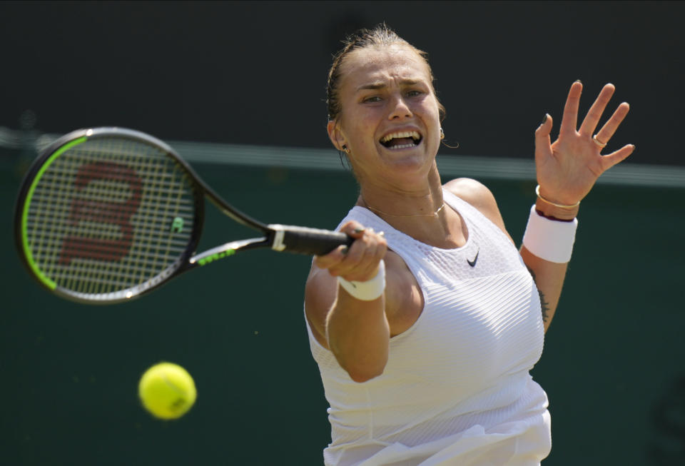 Belarus's Aryna Sabalenka plays a return to Colombia's Maria Camila Osorio Serrano during the women's singles third round match on day five of the Wimbledon Tennis Championships in London, Friday July 2, 2021. (AP Photo/Alastair Grant)