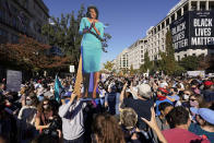 People gathered in Black Lives Matter Plaza react to the presidential race being called in favour of Democratic presidential candidate Joe Biden. (AP Photo/Alex Brandon)