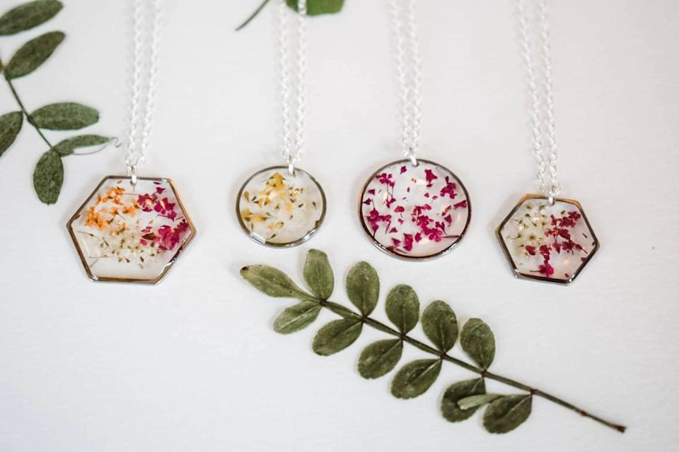<p>The <span>Birth Month Flower Necklace</span> ($30 and up) is a stunning yet unique piece they'll love to wear every day. It contains dried flower petals in resin. You can customize the shape and color of the metal. </p>
