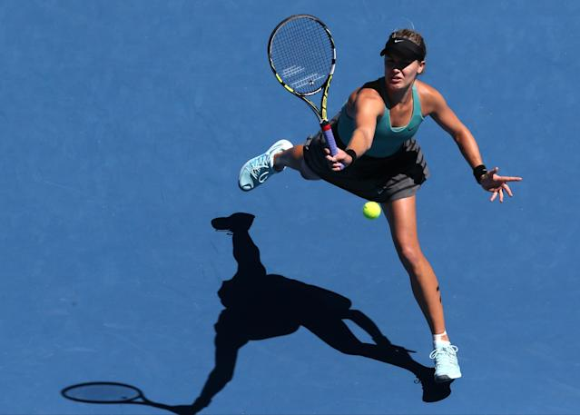 Eugenie Bouchard of Canada makes a forehand return during her quarterfinal against Ana Ivanovic of Serbia at the Australian Open tennis championship in Melbourne, Australia, Tuesday, Jan. 21, 2014.(AP Photo/Eugene Hoshiko)