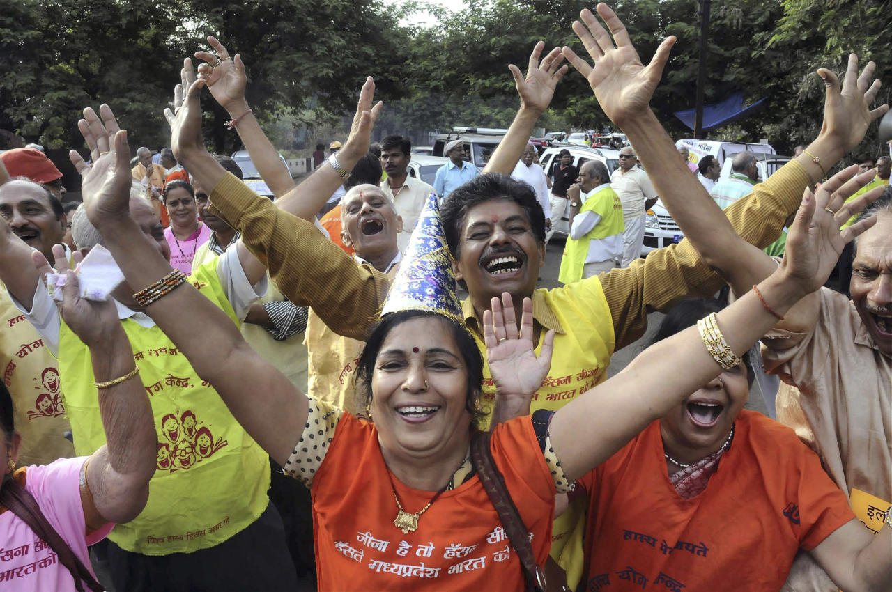 Bhopal laughter club members participate in a rally marking the 'World Laughter Day', in Bhopal, India, Sunday, May 2, 2010. (AP Photo)
