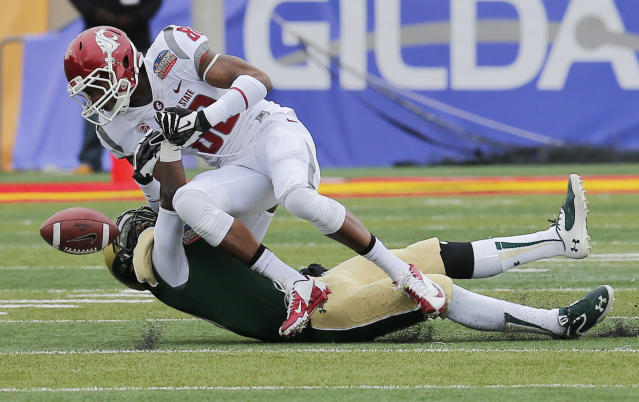 Colorado State defensive back DeAndre Elliott, bottom, breaks up a pass intended for Washington State wide receiver Dom Williams during the first half of the NCAA New Mexico Bowl college football game on Saturday, Dec. 21, 2013, in Albuquerque, N.M. (AP Photo/Matt York)