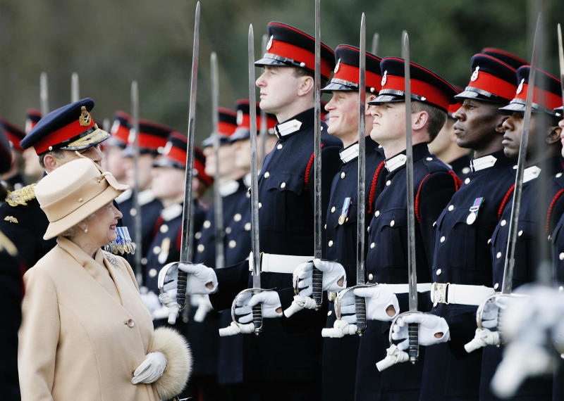 The Queen smiles at Prince Harry