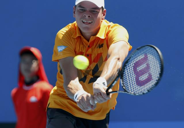 Milos Raonic of Canada hits a return to Daniel Gimeno-Traver of Spain during their men's singles match at the Australian Open 2014 tennis tournament in Melbourne January 14, 2014. REUTERS/Brandon Malone (AUSTRALIA - Tags: SPORT TENNIS)