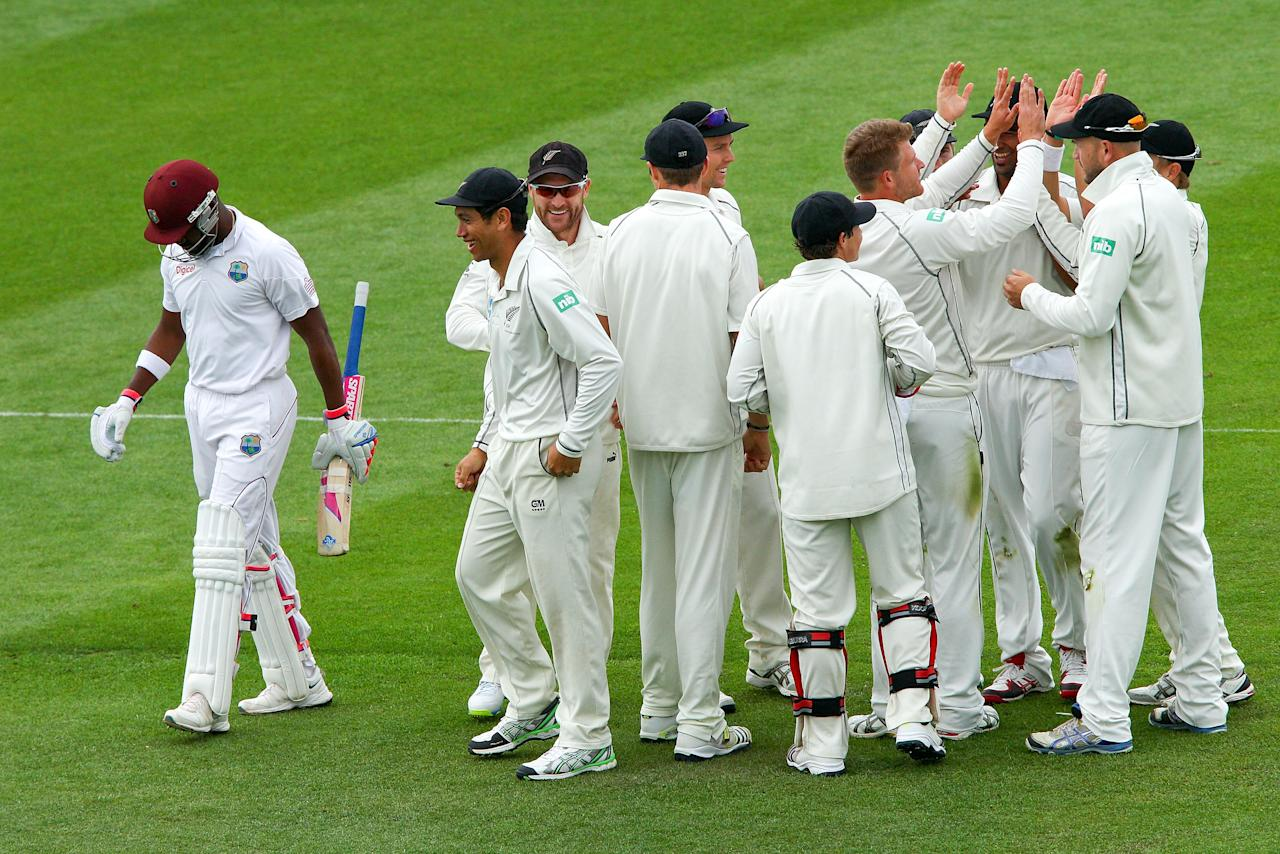WELLINGTON, NEW ZEALAND - DECEMBER 12:  Darren Bravo of the West Indies leaves the field after being dismissed by Corey Anderson of New Zealand during day two of the Second Test match between New Zealand and the West Indies at Basin Reserve on December 12, 2013 in Wellington, New Zealand.  (Photo by Hagen Hopkins/Getty Images)