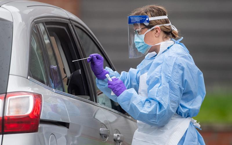 NHS staff carry out Coronavirus tests at a testing facility in Bracebridge Heath, Lincoln - PA
