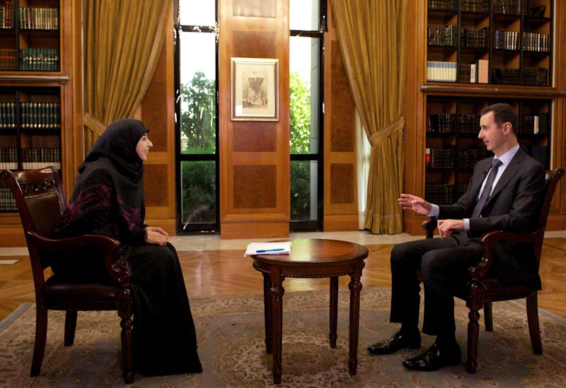 In this photo released by the Syrian official news agency SANA, Syrian President Bashar al-Assad, right, speaks during an interview with Al-Manar TV, owned by the militant Hezbollah group, in Damascus, Syria, Thursday, May 30, 2013.(AP Photo/SANA)