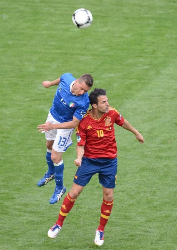Italian midfielder Emanuele Giaccherini (L) vies with Spanish forward Cesc Fabregas during the Euro 2012 championships football match Spain vs Italy on June 10, 2012 at the Gdansk Arena. AFPPHOTO/ PATRIK STOLLARZPATRIK STOLLARZ/AFP/GettyImages