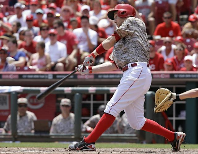 Cincinnati Reds' Todd Frazier hits a two-run home run off Toronto Blue Jays starting pitcher R.A. Dickey in the fifth inning of a baseball game on Sunday, June 22, 2014, in Cincinnati. (AP Photo/Al Behrman)