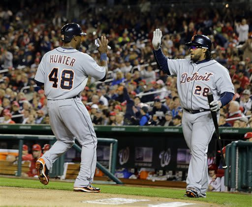Detroit Tigers' Torii Hunter (48) celebrates scoring with Prince Fielder (28) during the third inning of a baseball game against the Washington Nationals at Nationals Park, Wednesday, May 8, 2013, in Washington. (AP Photo/Alex Brandon)