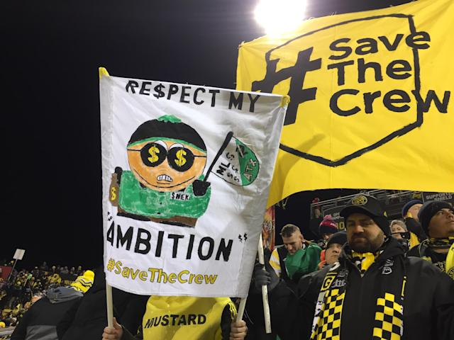 "Two <a class=""link rapid-noclick-resp"" href=""/soccer/teams/columbus-crew/"" data-ylk=""slk:Columbus Crew"">Columbus Crew</a> fans hold banners during the match against NYCFC. (Henry Bushnell/Yahoo Sports)"