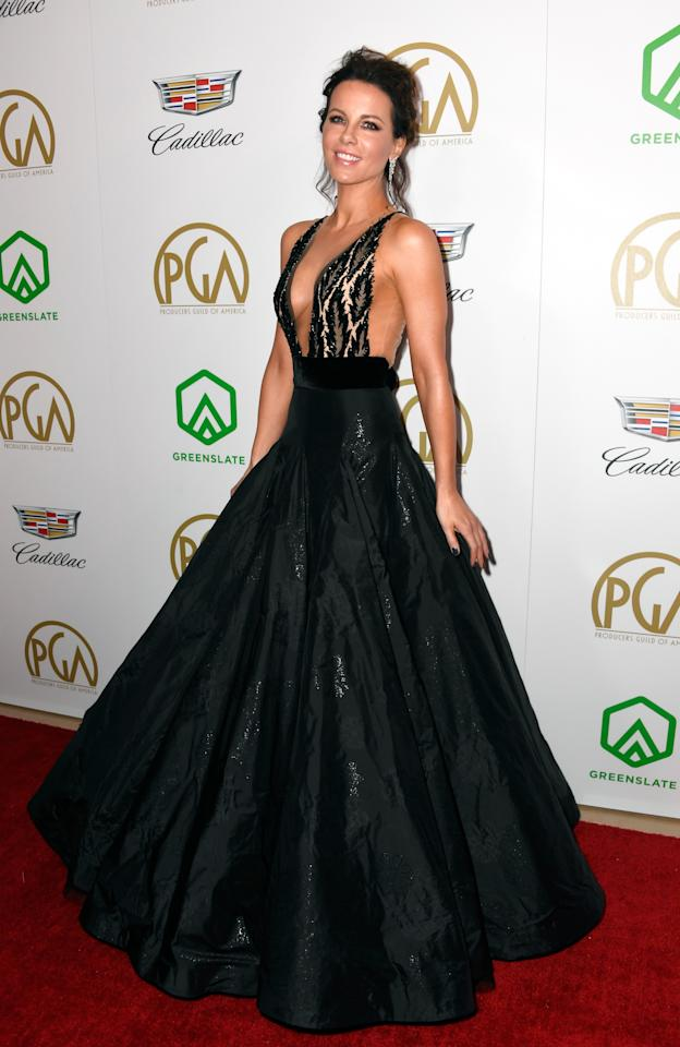 <p>On January 19, Kate Beckinsale graced the red carpet in a camera-ready Yanina Couture gown accessorised with Brian Atwood shoes. <em>[Photo: Getty]</em> </p>