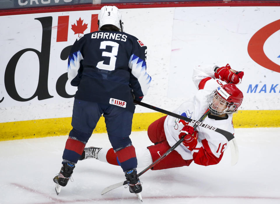 Russia's Ilona Markova, right, is checked by Cayla Barnes, of the United States, during second period IIHF Women's World Championship hockey action in Calgary, Alberta, Tuesday, Aug. 24, 2021. (Jeff McIntosh/The Canadian Press via AP)