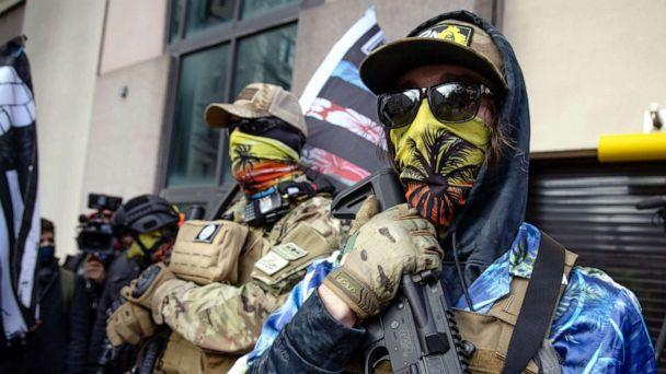 PHOTO: RICHMOND,VA-JAN18: Members of the Boogaloo Bois group stand armed on Gun Lobby Day outside the Virginia Capitol in Richmond, Va., Jan. 18, 2021. (The Washington Post via Getty Images, FILE)