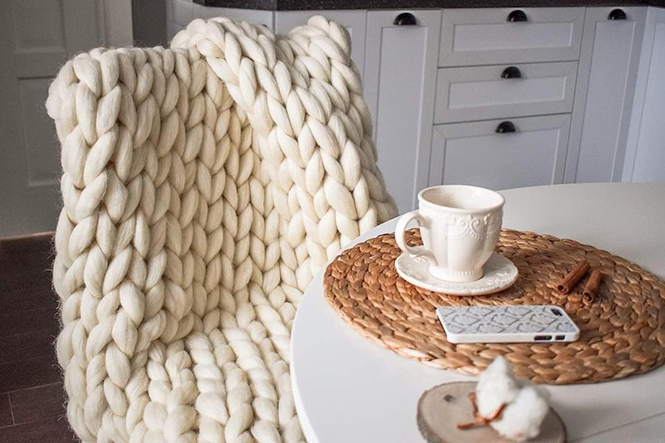 <p>You can't go wrong with the <span>Chunky Knit Merino Wool Blanket Large Throw Blanket</span> ($199), especially if they love to cuddle up on the couch with a good book. It's extremely soft and will bring the cozy vibes to their environment.</p>