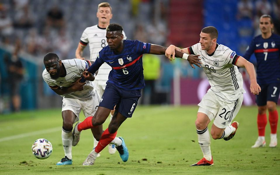 Pogba is hauled back by Rudiger (left) and Robin Gosens - REUTERS
