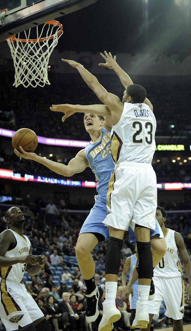 Denver Nuggets center Timofey Mozgov (25) shoots under New Orleans Pelicans center Anthony Davis (23) during the first half of an NBA basketball game in New Orleans, Friday, Dec. 27, 2013. (AP Photo/ Stacy Revere)