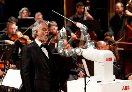 Watch a robot conduct an Italian orchestra and a famous tenor